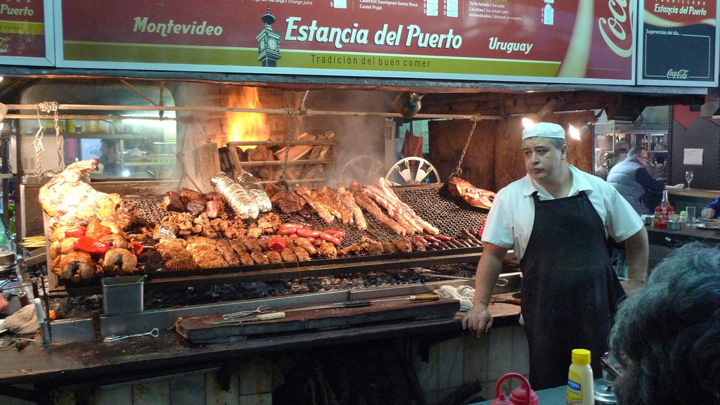 Meats on the barbecue at the port market in Montevideo, Uruguay Photo Credit: John Walker